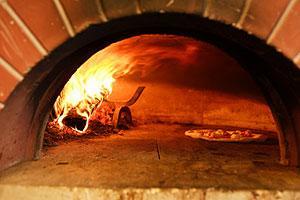 Pulizia del forno a legna